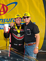 Sep 29, 2019; Madison, IL, USA; NHRA top fuel driver Billy Torrence (left) celebrates with son Steve Torrence after winning the Midwest Nationals at World Wide Technology Raceway. Mandatory Credit: Mark J. Rebilas-USA TODAY Sports