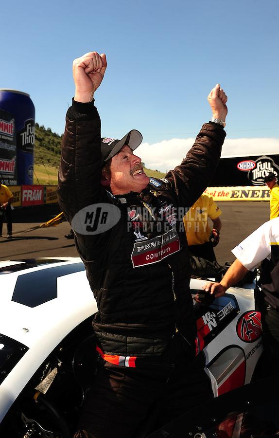 Jul. 24, 2011; Morrison, CO, USA: NHRA pro stock driver Mike Edwards celebrates after winning the Mile High Nationals at Bandimere Speedway. Mandatory Credit: Mark J. Rebilas-
