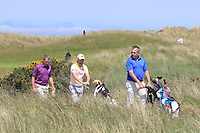 Mark Collins (Killeen Castle), Runar Arnorsson (Iceland) and Pat Murray (Clontarf) walking to the 3rd tee during Round 2 of the East of Ireland Amateur Open Championship 2018 at Co. Louth Golf Club, Baltray, Co. Louth on Sunday 3rd June 2018.<br /> Picture:  Thos Caffrey / Golffile<br /> <br /> All photo usage must carry mandatory copyright credit (&copy; Golffile | Thos Caffrey)