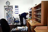 Jacek Serkiew, 60-years old Polish postman sorting the letters to be delivered today. It's winter and he works in snow covered Piaseczno in central Poland. Jacek is celebrating 40-th anniversary of his work as a postman..January 2010.(Photo by Piotr Malecki / Napo Images)..Praca listonosza. Jacek Serkiew przygotowuje listy do doreczenia. Jacek wlasnie obchodzi czterdziestolecie pracy na tym stanowisku. .Piaseczno, Styczen 2010.(Photo by Piotr Malecki / Napo Images) ..