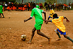 Two boys fight for the ball in a soccer game at Hamomi Children's Centre in Nairobi, Kenya