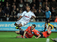 Pictured: Wayne Routledge of Swansea (TOP) is brought down by Clint Hill of QPR. Tuesday 27 December 2011<br /> Re: Premier League football Swansea City FC v Queens Park Rangers at the Liberty Stadium, south Wales.