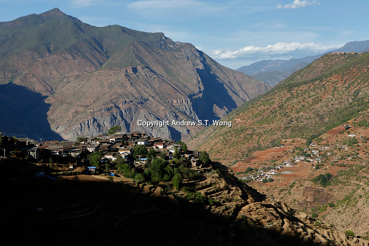 Wumu Village, Yulong County, Yunnan Province, China - A general view of Wumu Village where Dongba priest He Jixian of the Naxi ethnic group and his family are living, June 2019.