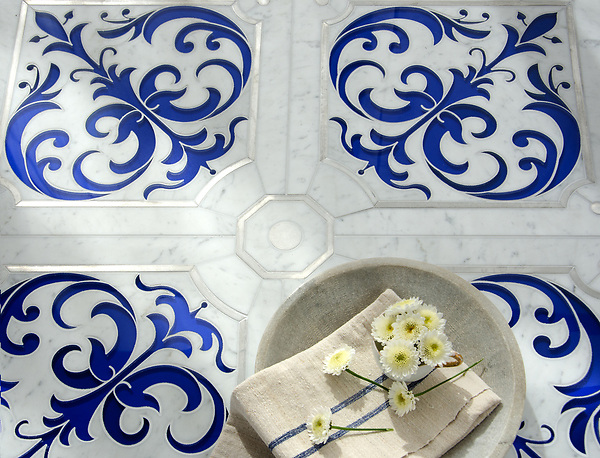 Jardin de Giverny, a waterjet stone mosaic, shown in polished Carrara, brushed Aluminum, and Brilliant Blue Serenity glass, is part of the Jardins Français™ collection by Caroline Beaupere for New Ravenna.