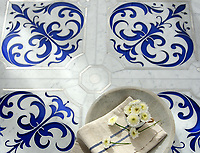 Jardin de Giverny, a waterjet stone mosaic, shown in polished Carrara, brushed Aluminum, and Brillant Blue Serenity glass, is part of the Jardins Français collection by Caroline Beaupere for New Ravenna.