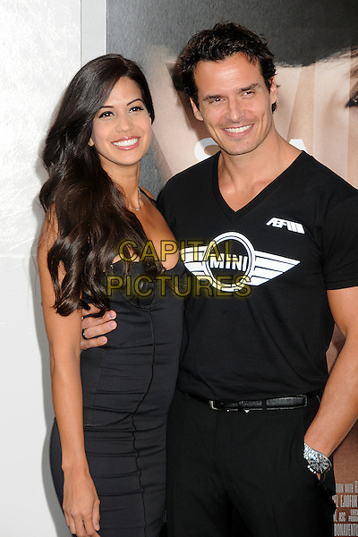 "CHERYL MOANA MARIE & ANTONIO SABATO JR. .""Salt"" Los Angeles Premiere held at Grauman's Chinese Theatre, Hollywood, California, USA, 19th July 2010..half length black t-shirt mini logo arm around .CAP/ADM/BP.©Byron Purvis/AdMedia/Capital Pictures."