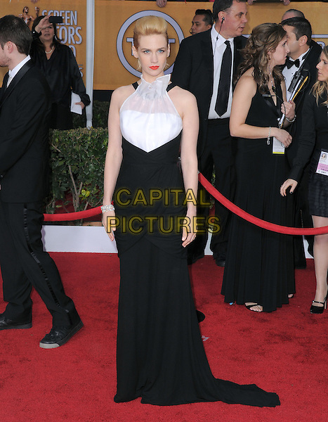 January Jones (wearing Prabal Gurung).Arrivals at the 19th Annual Screen Actors Guild Awards at the Shrine Auditorium in Los Angeles, California, USA..27th January 2013.SAG SAGs full length black white sleeveless halterneck dress ruffle sheer.CAP/DVS.©DVS/Capital Pictures.