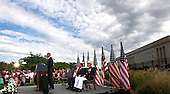 United States President Barack Obama delivers remarks at the Pentagon Memorial in Washington, DC during an observance ceremony to commemorate the 15th anniversary of the 9/11 terrorist attacks, Sunday, September 11, 2016. Seated behind the President are US Secretary of Defense Ash Carter, left, and US Marine Corps General Joseph F. Dunford Jr., Chairman of the Joint Chiefs of Staff, right.<br /> Credit: Dennis Brack / Pool via CNP