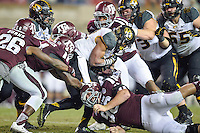 Missouri tackle Russell Hansbrough (32) is brought down my Texas A&M defensive lineman Jay Arnold (96) during an NCAA football game, Saturday, November 15, 2014 in College Station, Tex. Missouri defeated Texas A&M 34-27. (Mo Khursheed/TFV Media via AP Images)
