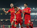 Jordan Henderson of Liverpool (L) and Emre Can of Liverpool (R) celebrate with second goal scorer James Milner of Liverpool (C) during the Premier League match at the Anfield Stadium, Liverpool. Picture date: November 26th, 2016. Pic Simon Bellis/Sportimage