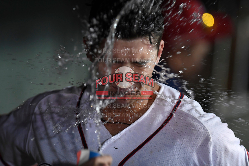 Third baseman Bobby Dalbec (23) of the Greenville Drive gets a splash of water in the face after hitting a three-run home run in the eithgh inning of Game 3 of the South Atlantic League Southern Division Playoff against the Charleston RiverDogs on Saturday, September 9, 2017, at Fluor Field at the West End in Greenville, South Carolina. Greenville won, 5-0, winning the division championship two games to one. (Tom Priddy/Four Seam Images)