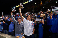 Chicago Cubs fans hold up signs for the Stand Up To Cancer ceremony in the fifth inning during Game 4 of the Major League Baseball World Series against the Cleveland Indians on October 29, 2016 at Wrigley Field in Chicago, Illinois.  (Mike Janes/Four Seam Images)