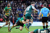 Mike Fitzgerald of Leicester Tigers is tackled by Paul Hill of Northampton Saints. Aviva Premiership match, between Northampton Saints and Leicester Tigers on April 16, 2016 at Franklin's Gardens in Northampton, England. Photo by: Patrick Khachfe / JMP