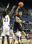 Foothill's Tanjunique Ajeto passes past Reed's Nyasha LeSure during a semi-final game in the NIAA 4A State Basketball Championships between Reed and Foothill high schools at Lawlor Events Center in Reno, Nev, on Thursday, Feb. 23, 2012. .Photo by Cathleen Allison