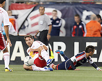 New York Red Bulls defender Heath Pearce (3) slide tackles New England Revolution forward Diego Fagundez (14). Despite a red-card man advantage, in a Major League Soccer (MLS) match, the New England Revolution tied New York Red Bulls, 1-1, at Gillette Stadium on September 22, 2012.