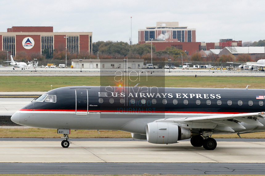 A US Airways plane on the tarmac at Hartsfield-Jackson Atlanta International Airport. US Airways has made a bid to take over Delta Air Lines, which is headquartered in Atlanta.<br />