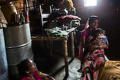 Sister Karuna (left) speaks with 22 year old Seema Devi in her hut in Khurmaniya village in Raxaul district of Bihar. Seema Devi lost 5 of her children and her 6th child, Krishna was born in a government hospital. She is doing everything to make sure her son stays healthy.