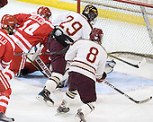 Mike Miller (Bu - 14), Brian Isaac (BC - 29), Pat Morris (BC - 8) - The Boston College Eagles defeated the visiting Boston University Terriers 6-2 in ACHA play on Sunday, December 4, 2011, at Kelley Rink in Conte Forum in Chestnut Hill, Massachusetts.