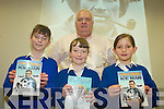 CREAN: Enjoying the lecture by Tom Crean author, Michael Smith at Tralee Library on Friday morning were Kilflynn school pupils, l-r: Aisling Breen, Edith White, Lilou Le Prince with Michael Smith at back.   Copyright Kerry's Eye 2008
