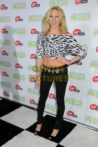"DEBORAH GIBSON.""Take Me Home Tonight"" Los Angeles Premiere held at Regal Cinemas LA Live, Los Angeles, California, USA..March 2nd, 2011.full length black white jeans denim top leopard print top belly stomach midriff  debbie hand on hip mouth open.CAP/ADM/BP.©Byron Purvis/AdMedia/Capital Pictures."