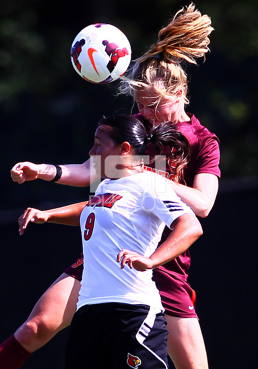 WINSTON-SALEM, NORTH CAROLINA - August 30, 2013:<br />  Charlyn Corral (9) of Louisville University battles for the ball in the air with Kelsey Loupee (9) of Virginia Tech during a match at the Wake Forest Invitational tournament at Wake Forest University on August 30. The game ended in a 1-1 tie.