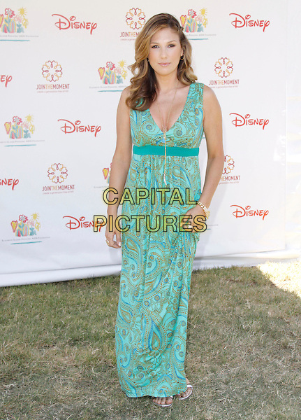"DAISY FUENTES.The 20th annual ""A Time for Heroes"" Celebrity Carnival benefiting Elizabeth Glaser Pediatric AIDS Foundation held at Wadsworth Theater on the Veteran Administration Lawn in West Los Angeles, California, USA. .June 7th, 2009.full length long maxi dress pattern green paisley print .CAP/DVS                                                  .©Debbie VanStory/Capital Pictures."