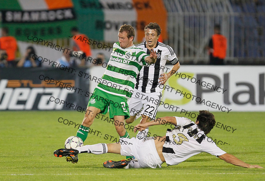 Billy Dennehy of Shamrock Rovers, left, is challenged for the ball with Vladimir Volkov of Partizan Belgrade , during their UEFA Europa League play off, second leg, in Belgrade, Serbia, Thursday, August 25, 2011. (Srdjan Stevanovic/Starsportphoto ©)