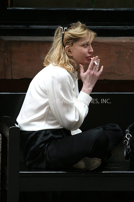 WWW.ACEPIXS.COM ************....May 17 2010, New York City....Singer Courtney Love enjoys a cigarette outside a hotel in Soho on May 17 2010 in New York City....Please byline: PHILIP VAUGHAN - ACEPIXS.COM.. *** ***  ..Ace Pictures, Inc:  ..tel: (646) 769 0430..e-mail: info@acepixs.com..web: http://www.acepixs.com