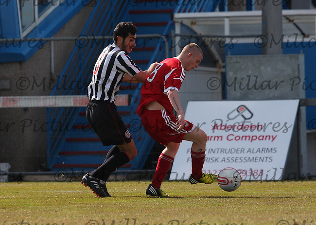 Craig Storie being pressured by Mo Yaqub in the Aberdeen v St Mirren Clydesdale Bank Scottish Premier League Under 20 match played at Balmoor Stadium, Peterhead on 19.4.13.