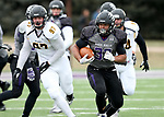SIOUX FALLS, SD - NOVEMBER 10: Gabriel Watson #33 from the University of South Falls breaks loose past Jacob Protzman #97 from Wayne State during their game Saturday afternoon at Bob Young Field in Sioux Falls. (Photo by Dave Eggen/Inertia)