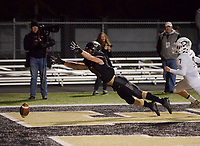 NWA Democrat-Gazette/CHARLIE KAIJO Bentonville High School Harrison Campbell (21) misses a pass in the end zone thrown long during a football game, Friday, November 2, 2018 at Bentonville High School in Bentonville.