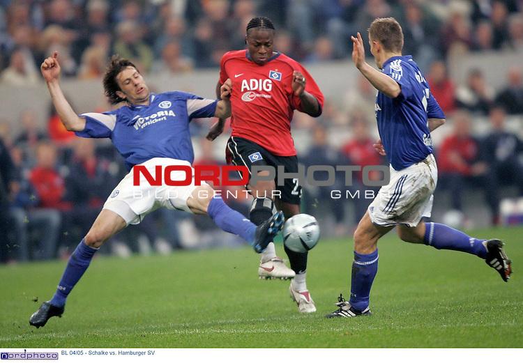 BL 2004/2005 -  29. Spieltag - RŁckrunde<br /> <br /> FC Schalke 04 vs. Hamburger SV<br /> <br /> <br /> <br /> Emile Mpenza (Mitte) vom Hamburger SV im Zweikampf mit Mladen Krstajic (links) und Tomasz Waldoch (rechts) von Schalke 04.<br /> <br /> <br /> <br /> Foto &copy; nordphoto - Ruediger Lampe<br /> <br /> <br /> <br />  *** Local Caption *** Foto ist honorarpflichtig! zzgl. gesetzl. MwSt.<br /> <br /> Belegexemplar erforderlich<br /> <br /> Adresse: nordphoto<br /> <br /> Georg-Reinke-Strasse 1<br /> <br /> 49377 Vechta