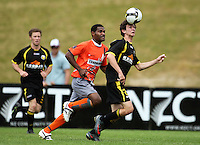 Richard McLay controls the ball chased by Waikato's Maurie Wasi..NZFC soccer  - Team Wellington v Waikato FC at Newtown Park, Wellington. Sunday, 20 December 2009. Photo: Dave Lintott/lintottphoto.co.nz