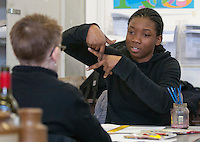 Hearing impaired student and her Student Support Worker using British Sign Language, Art & Design, Kingston College.