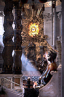 Statue St Peter Basilica St Peter at the Vatican, Chair of Saint Peter.The Cathedra Petri (Latin) or Chair of Saint Peter is a relic conserved in St. Peter's Basilica, Rome, enclosed in a gilt bronze casing that was designed by Gian Lorenzo Bernini and executed 1647-53..Above the throne in a stuccowork dorati radial surrounded by angels, is a finestrone of Fund in Alabaster depicting a dove (the wingspan is 162 cm), symbol (which, according to the Catholic doctrine, guide the successors of Peter in their job) Holy Spirit. It is the only stained glass colored the entire Basilica of Saint Peter..