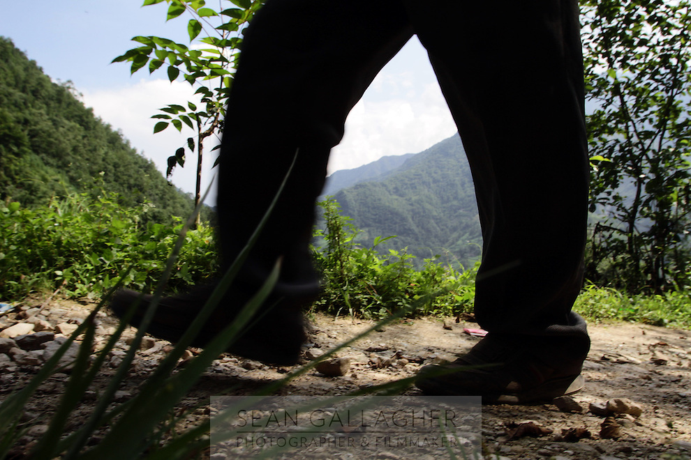 A man walks through the mountainous forests in Pingwu County in Sichuan Province, south-west China.
