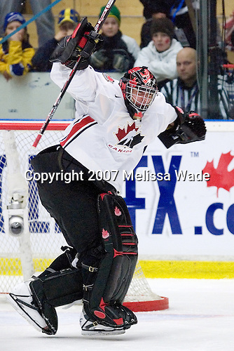 Carey Price (Anahim Lake, BC - Tri-City Americans) celebrates as his stop on Mueller wins the game. Team Canada defeated Team USA 2-1 by winning the seventh round of the shootout on Wednesday, January 3, 2007 at Ejendals Arena in Leksand, Sweden.  The result gave Team Canada the opportunity to play for the gold medal and Team USA the opportunity to play for the bronze medal.