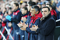 Swansea manager Carlos Carvalhal (R) applauds before kick off during the Premier League match between Swansea City and Liverpool at The Liberty Stadium, Swansea, Wales, UK. Monday 22 January 2018