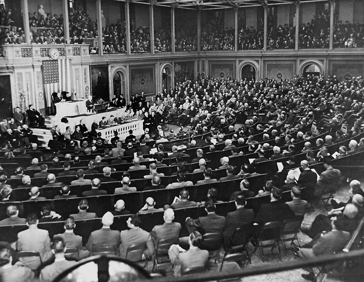 President Harry S. Truman speaks to Congress in joint session. Behind President Harry S. Truman, are President Pro Tempore Sen. Arthur H. Vandenberg, R-Mich., and Speaker Rep. Joseph William Martin, R-Mass., on Nov. 17, 1947. (Photo by Laura Patterson/CQ Roll Call via Getty Images)