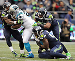 Seattle Seahawks  free safety Earl Thomas (29) and linebacker Bruce Irvin (51) andd K.J. Wright (50) tackles Carolina Panthers  running back Jonathan Stewart (28) at CenturyLink Field in Seattle on October 18, 2015. The Panthers came from behind with 32 seconds remaining in the 4th Quarter to beat the Seahawks 27-23.  ©2015 Jim Bryant Photography. All Rights Reserved.