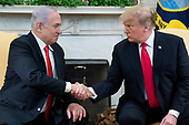 US President Donald J. Trump (R) and Prime Minister of Israel Benjamin Netanyahu (L) shake hands in the Oval Office of the White House in Washington, DC, USA, 25 March 2019. Trump earlier signed an order recognizing Golan Heights as Israeli territory.<br /> Credit: Michael Reynolds / Pool via CNP
