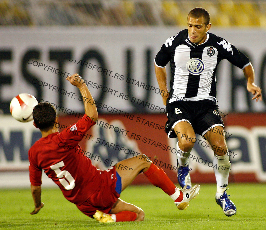 Partizan Belgrade player Liliano Roberto Antonello Juca from Brazil, right, is challenged for the ball with Davor Landeka, left, from Zrinjski, Mostar, Bosnia and Herzegovina, during UEFA Cup, first qualifying round, second leg, soccer match in Belgrade, Serbia, Thursday, Aug. 2, 2007. (Srdjan Stevanovic/starsportphoto.com)