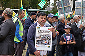 Kashmiris protest outside Parliament following India's actions in Indian-controlled Kashmir.  Westminster, London.