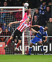 Lincoln City's Josh Vickers punches clear under pressure from Rob Dickie and Chesterfield's Chris O'Grady<br /> <br /> Photographer Chris Vaughan/CameraSport<br /> <br /> The EFL Sky Bet League Two - Lincoln City v Chesterfield - Saturday 7th October 2017 - Sincil Bank - Lincoln<br /> <br /> World Copyright &copy; 2017 CameraSport. All rights reserved. 43 Linden Ave. Countesthorpe. Leicester. England. LE8 5PG - Tel: +44 (0) 116 277 4147 - admin@camerasport.com - www.camerasport.com