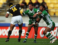 Wellington winger David Smith tries to step round Aaron Cruden and Johnny Leota. Air NZ Cup - Wellington Lions v Manawatu Turbos at Westpac Stadium, Wellington, New Zealand. Saturday 3 October 2009. Photo: Dave Lintott / lintottphoto.co.nz