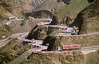 Vehicles make their way along The Grand Trunk Road through a narrow part of the Khyber Pass which marks the border with Afghanistan.