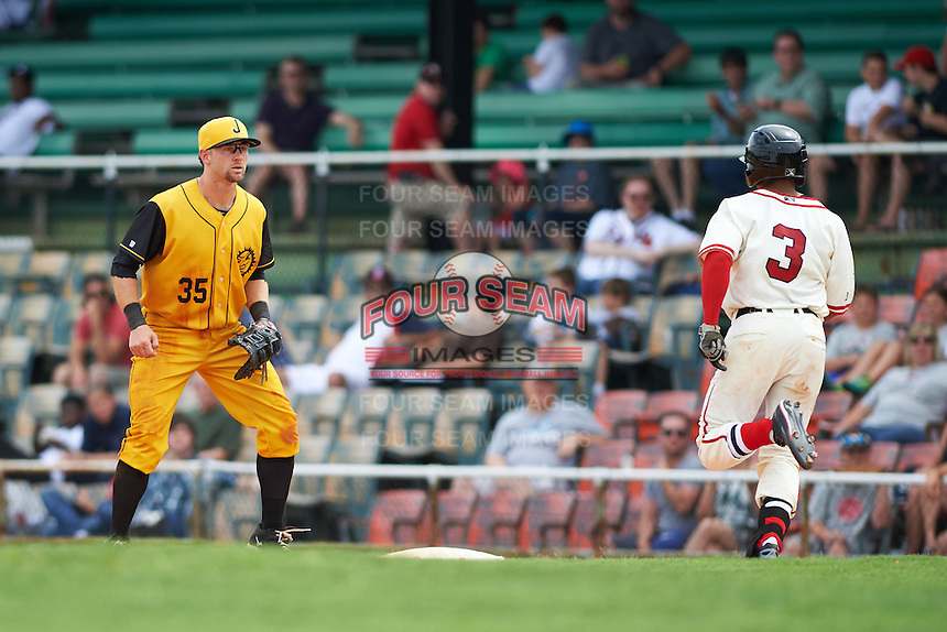 Jacksonville Suns first baseman David Adams (35) waits for a throw as Jacob May (3) runs through the bag during the 20th Annual Rickwood Classic Game against the Birmingham Barons on May 27, 2015 at Rickwood Field in Birmingham, Alabama.  Jacksonville defeated Birmingham by the score of 8-2 at the countries oldest ballpark, Rickwood opened in 1910 and has been most notably the home of the Birmingham Barons of the Southern League and Birmingham Black Barons of the Negro League.  (Mike Janes/Four Seam Images)