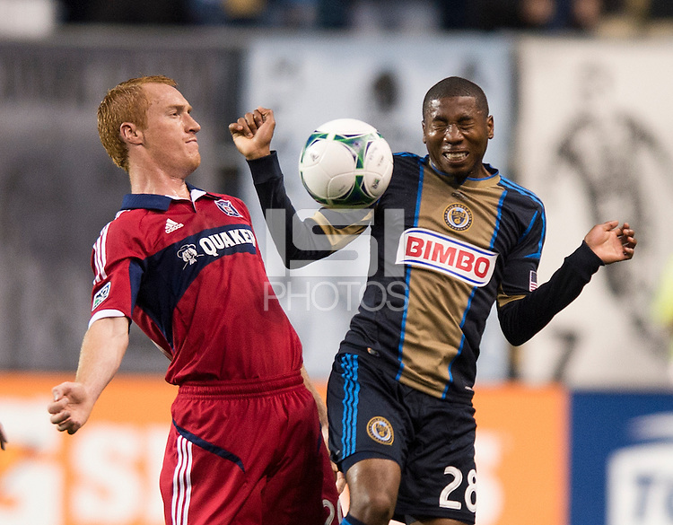 Jeff Larentowicz (20) of the Chicago Fire fights for the ball with Raymon Gaddis (28) of the Philadelphia Union during a Major League Soccer match at PPL Park in Chester, PA.  Philadelphia defeated Chicago, 1-0.