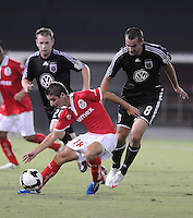 Toluca FC forward Isaac Brizuela (18)  shields the ball against DC United midfielder Andrew Jacobson (8).  Toluca FC defeated DC United 3-1in the Concacaf Champions League tournament,at RFK Stadium Wednesday, August 26  2009.