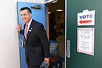 Nevada Gov. Brian Sandoval votes in Reno, Nev., on Tuesday, Nov. 4, 2014. Sandoval is expected to cruise to re-election over a little-known Democrat. (AP Photo/Cathleen Allison)